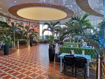 Modern lounge bar at Therme Bucharest, Romania. Palm trees and modern furniture royalty free stock photo