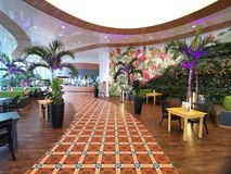 Modern lounge bar at Therme Bucharest, Romania. Palm trees and modern furniture stock photos