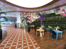 Modern lounge bar at Therme Bucharest, Romania. Palm trees and modern furniture royalty free stock photos