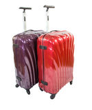 Modern Luggage Bags II. Red and purple luggage bags over white background royalty free stock photos