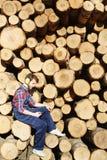 Modern Lumberjack Using Smartphone Royalty Free Stock Image