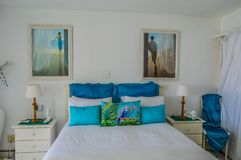 A modern luxurious and comfortable bed room in white and blue colors stock photo