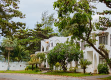 Modern and luxurious residence holiday villa house, exterior facade of building on resort. Front view. Lifestyle concept Royalty Free Stock Image