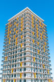 Modern luxury apartment block over blue sky. Multistoried modern and stylish living block of flats. Real estate Royalty Free Stock Image