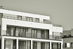 Facade of a modern apartment building. Black and white. Modern, Luxury Apartment Building. Modern facade royalty free stock images