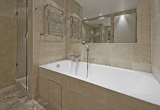 Modern luxury bathroom. With floor to ceiling marble tiles Royalty Free Stock Photography