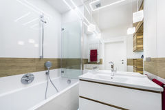 Modern luxury bathroom with bath. In a white style stock photo