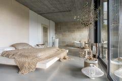 Modern luxury bedroom. In a minimalist villa Stock Images