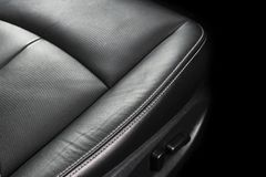 Modern luxury car black leather interior. Part of leather car seat details with stitching. Interior of prestige modern car. Comfor. Table perforated leather stock image