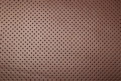 Modern luxury Car brown leather interior. Part of leather car seat details with white stitching. Interior of prestige car. Comfort. Able perforated leather seats stock image