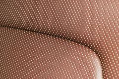 Modern luxury Car brown leather interior. Part of leather car seat details with white stitching. Interior of prestige car. Comfort. Able perforated leather seats royalty free stock image