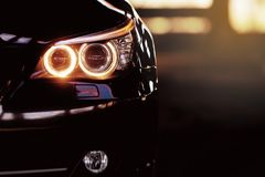 Modern luxury car close-up banner background. Concept of expensive, sports auto. royalty free stock images