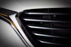 Modern luxury car close-up of grille. Expensive, sports auto detailing. Modern luxury car close-up of grille. Background, concept of expensive, sports auto stock photo