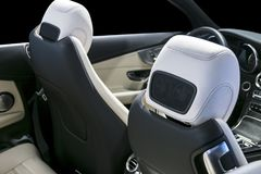 Free Modern Luxury Car Inside. Interior Of Prestige Car. Comfortable White Perforated Leather Seats. And Cockpit. Steering Wheel Royalty Free Stock Images - 107984829