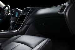 Modern Luxury car inside. Interior of prestige modern car. Comfortable leather seats. Black perforated leather cockpit. Steering w. Heel and dashboard. Automatic stock photo