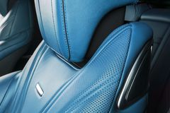 Modern Luxury car inside. Interior of prestige modern car. Comfortable leather red seats. Blue perforated leather. Modern car. Interior details Stock Photo