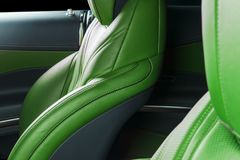 Modern Luxury car inside. Interior of prestige modern car. Comfortable leather red seats. Green perforated leather. Modern car. Interior details Royalty Free Stock Photo