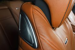 Modern Luxury car inside. Interior of prestige modern car. Comfortable leather red seats. Orange perforated leather. Modern car. Interior details Royalty Free Stock Photos