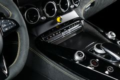 Modern Luxury car inside. Interior of prestige modern car. Comfortable leather seats. Black perforated leather with yellow stitchi. Ng. Steering wheel and royalty free stock images