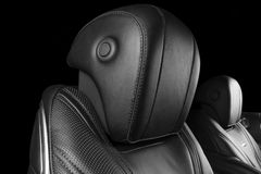 Modern Luxury car inside. Interior of prestige modern car. Comfortable leather seats. Perforated leather with isolated Black backg. Round. Modern car interior stock images