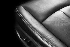 Modern Luxury car inside. Interior of prestige modern car. Comfortable leather seats. Perforated leather with stitching isolated o. N black background. Modern royalty free stock photography