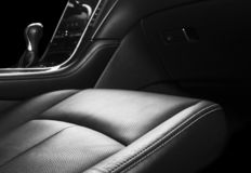 Modern Luxury car inside. Interior of prestige modern car. Comfortable leather seats. Perforated leather with stitching isolated o. N black background. Modern stock photography