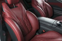 Modern Luxury car inside. Interior of prestige modern car. Comfortable leather red seats. Red perforated leather cockpit. With Black background. Modern car stock photos