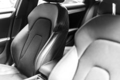 Modern Luxury car inside. Interior of prestige modern car. Comfortable leather seats. Black perforated leather cockpit. Steering w. Heel and dashboard. automatic stock images
