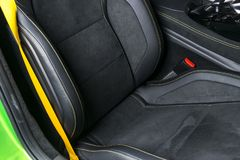 Modern Luxury car inside. Interior of prestige modern car. Comfortable leather seats. Black perforated leather with yellow s Royalty Free Stock Images