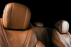 Modern Luxury car inside. Interior of prestige modern car. Comfortable leather seats. Brown perforated leather cockpit. With isolated Black background. Modern Royalty Free Stock Photos
