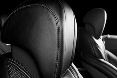 Modern Luxury car inside. Interior of prestige modern car. Comfortable leather seats. Perforated leather. Modern car interior deta. Ils. Black and white royalty free stock photo