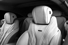 Modern Luxury car inside. Interior of prestige modern car. Comfortable leather seats. Perforated leather. Modern car interior deta. Ils. Black and white royalty free stock image