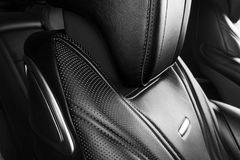 Modern Luxury car inside. Interior of prestige modern car. Comfortable leather seats. Perforated leather. Modern car interior deta. Ils. Black and white royalty free stock photos