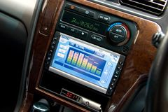Modern luxury car interior. Tv/dvd/audio system with monitor and climat control view Royalty Free Stock Photography