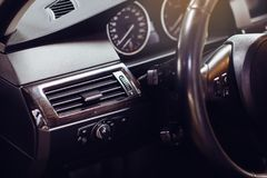 Modern luxury car Interior - steering wheel, shift lever and dashboard. stock photo