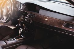 Modern luxury car Interior - steering wheel, shift lever and dashboard. royalty free stock photography