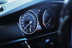 Modern luxury car Interior - steering wheel, shift lever and dashboard. royalty free stock photos
