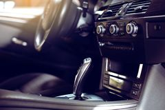 Modern luxury car Interior - steering wheel, shift lever and dashboard. royalty free stock photo