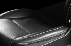 Modern luxury car leather interior. Part of leather car seat details with white stitching. Interior of prestige car. Comfortable p. Erforated leather seats royalty free stock photo