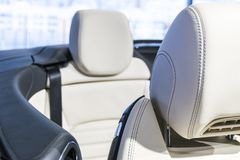 Modern luxury car perforated stitched white leather interior.Part of leather car seat details. Modern car white leather interior. Details Stock Photo