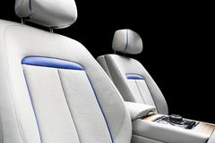 Modern luxury car white leather interior with natural wood panel. Part of leather car seat details with stitching. Interior of pre. Stige modern car. White stock images