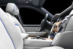 Modern luxury car white leather interior with natural wood panel. Part of leather car seat details with stitching. Interior of pre. Stige modern car. White royalty free stock image