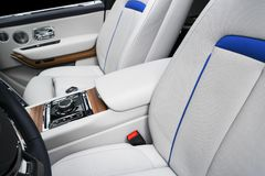 Modern luxury car white leather interior seat details with stitching. Interior of prestige modern car. White perforated leather. Car detailing. Car inside royalty free stock image