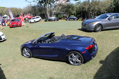 Modern luxury cars on lawn on display at event Royalty Free Stock Image