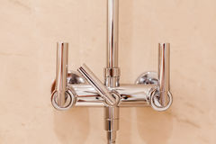 Modern luxury chrome shower tap. Front closeup view Royalty Free Stock Photos