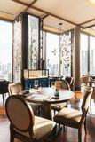 Modern luxury decorated interior restaurant that can view Bangkok cityscape. Elegant design for fine dining.  stock photography