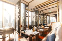Modern luxury decorated interior restaurant that can view Bangkok cityscape. Elegant design for fine dining.  royalty free stock images