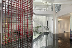 Modern luxury home. Modern foyer with glass walls and column Stock Images
