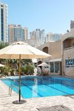 Modern luxury hotel with swimming pool. On sunny day royalty free stock images