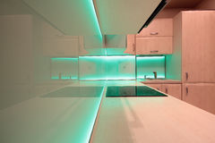 Modern luxury kitchen with green LED lighting Royalty Free Stock Image